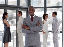 A Business man standing smiling with team Royalty Free Stock Photography