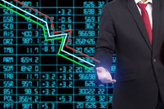 Business man standing with stock market Stock Image