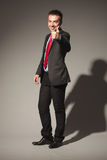 Business man standing on studio background Stock Photo