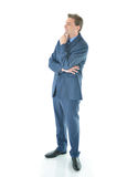 Business man standing and thinking Royalty Free Stock Image