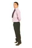 Business man standing on toes Royalty Free Stock Photo