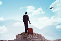 Business man standing on the top of the mountain Stock Image
