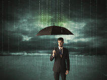Business man standing with umbrella data protection concept. On background Royalty Free Stock Photos