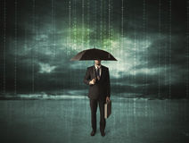 Business man standing with umbrella data protection concept Stock Photo
