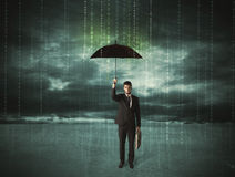 Business man standing with umbrella data protection concept Stock Photography