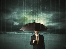 Business man standing with umbrella data protection concept. On background Stock Images