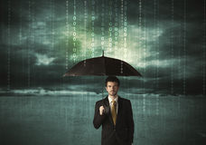 Business man standing with umbrella data protection concept. On background Stock Photography
