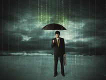Business man standing with umbrella data protection concept Stock Image
