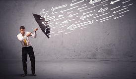 Business man standing with umbrella and drawn arrows hitting him Royalty Free Stock Photography