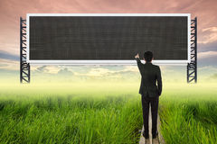 Business man standing on wood bridge between rice field and poin Royalty Free Stock Photography