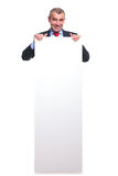 Business man stands behind board Stock Photography