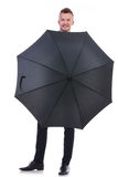 Business man stands behind opened umbrella Royalty Free Stock Image