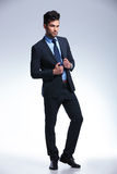 Business man stands with hands on jacket Royalty Free Stock Photos