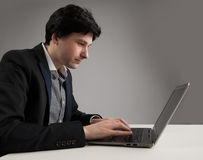Business man staring at his laptop Royalty Free Stock Images