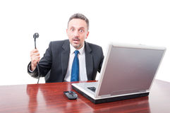 Business man staring and showing electricity wire at office Royalty Free Stock Photo