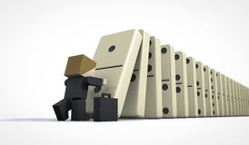 Business man starting domino effect. Perspective view of a business man starting domino effect Royalty Free Stock Photos
