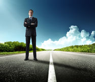 Business man on the road Royalty Free Stock Photos