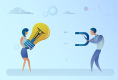 Business Man Stealing Light Bulb Idea From Woman Holding Magnet Concept Stock Photography