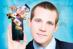 Business Man Steaming Media Apps On Smart Phone Royalty Free Stock Photo