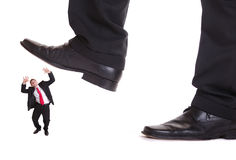 Business man steping on a fear man. Business men steping on a fear man, business concept , isolated on white background Royalty Free Stock Image