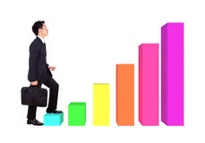 Business man stepping forward on a growing bar graph Stock Photo