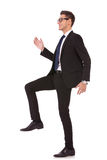 Business man stepping up Stock Photo