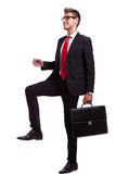 Business man stepping up Stock Images