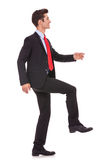 Business man stepping up and moving forward Stock Photo