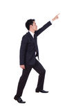 Business man stepping up and pointing to target isolated on whit Royalty Free Stock Photography