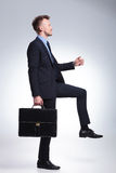 Business man steps with briefcase Royalty Free Stock Images