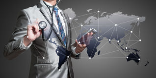 Business man with stethoscope, business analysis concept Stock Image