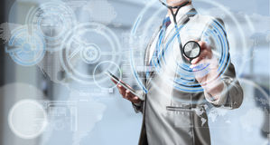 Business man with stethoscope, business analysis concept Royalty Free Stock Photography