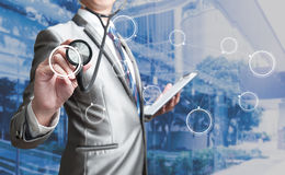 Business man with stethoscope. Business concept Royalty Free Stock Photos