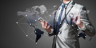 Business man with stethoscope, globalisation concept Royalty Free Stock Photo