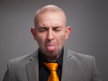 Business man sticking out his tongue Royalty Free Stock Photography