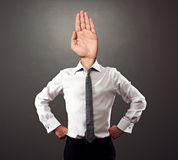 Business man with stop gesture. Instead of the head over grey background Stock Photo