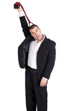 Business man strangling himself with tie Stock Photography