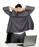 Business man stratching. Business man in his office stratching his back Royalty Free Stock Image