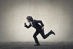 Business man on the street. Man is running  on the street Stock Image