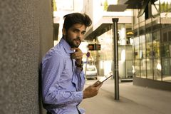 Business man on street using iPod. Space for copy Stock Image