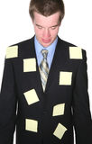 Business Man Stress. A business man looking stressed with a bunch of post-its on his suit Royalty Free Stock Image