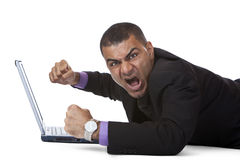 Business man stressed because of computer crash. Businessman has stress because of computer problem. Isolated on white. Complete digital workflow stock image