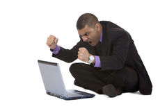 Business man stressed because of computer crash. Businessman has stress because of computer problem. Isolated on white. Complete digital workflow royalty free stock image