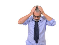 Business man stressed. Concept of mature business man stressed for too many work commitments royalty free stock photography
