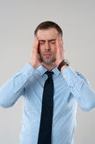 Business man stressed. Headache with hands on face. Stressed business man with headache isolated on grey background royalty free stock images