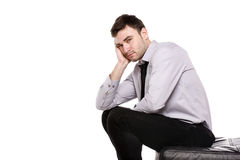 Business man sat in despair isolated on a white background. Business man stressed sat with his head in his hands isolated on a white background stock photos