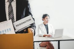 Business man stressing with resignation letter for quit a job packing the box and leaving the office , Resignation concept. Business men stressing with royalty free stock images
