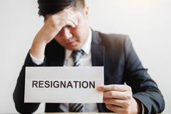 Business man stressing with resignation letter for quit a job packing the box and leaving the office , Resignation concept.  stock image