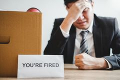 Business man stressing with resignation letter for quit a job packing the box and leaving the office , Resignation concept.  royalty free stock photo