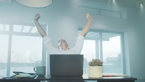 Business man stretching himself in luxury house. Tired man relaxing at workplace stock video